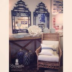 Oriental mirrors, wood console table, wicker chair. Available at Pineapples Palms Etc in Jupiter, Fl. 561-748-8303