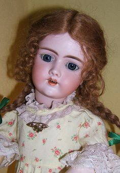 Beautiful antique doll. Open mouthed dolls are worth so much more because their are not many of  them.