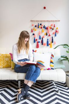 How to Make This Ridiculously Adorable Pom-Pom Tassel Wall Hanging via Brit + Co