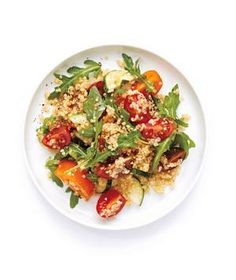 Tomato, Cucumber, and Quinoa Salad recipe: Nutty, filling quinoa makes a summery salad with fresh tomatoes, cucumbers, and arugula surprisingly hearty.