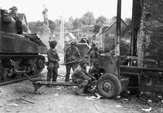The Pont Brocard July 29-30 GIs of the 2nd US Armored Division. The 57 mm anti-tank gun is the road from Cerisy la Salle.