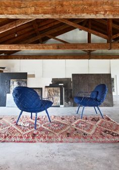 """Low Chair. Foot-stool. Material: legs in solid ash natural or painted. Seat in steel rod painted in polyester powder. Cushions with removable cover in fabric (Kvadrat """"Steelcut 2""""). Optional: loinrest cushion with removable cover."""