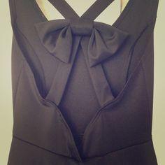 NEW LISTING✨BLACK SKATER DRESS Black skater dress • Halter with bow on back • Size Medium • 96% polyester, 4% spandex • Dresses