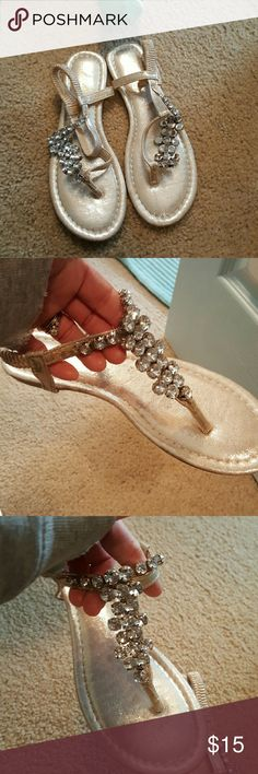 Very pretty summer spring sandals ?????? Very pretty silver & Diamond Sandals perfect for your springtime /Summer wardrobe these are so cute and has never been worn as you can see. These are so pretty I just have so many Shoes Sandals