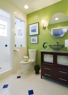 Love the colorful tile accents in this bathroom