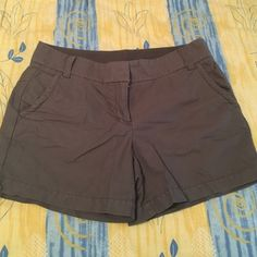J. CREW shorts These J. CREW shorts go great with any color. They are mainly a gray with a greenish tint to them. Size 8, excellent condition J. Crew Shorts