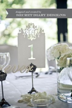 Elegant Table numbers for a wedding reception #White #DIY -- S&S, it's really sweet how the couples initials are cut into the design at the top of the table numbers. Additional interest can be added through the paper and/or color choice.