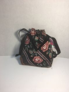 A personal favorite from my Etsy shop https://www.etsy.com/listing/517876746/black-with-red-roses-drawstring-bag