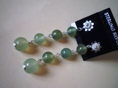 This earrings feature harmony between the Victorian style solid pure 925 sterling silver earstud and the natural forest green jade/jadeite stone. B