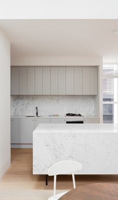 soft green/grey | modern country vibe | marble island | crisp white contrast | House in Double Bay - Tribe Studio Architects