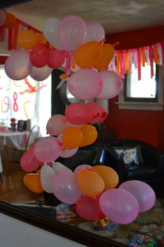 numbers party - double stick tape to create a balloon number on the wall - or free standing.
