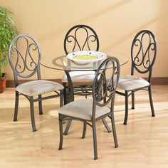 <li>Add a modern flair to your home dining decor with this classically styled table set</li><li>Table and chairs feature classic scrolled iron</li><li>Dining furniture is finished with a powder coated dark chocolate color</li> Dining Room Table Chairs, Brown Dining Table, Dining Furniture, Chair, Furniture, Dining Table Setting, Glass Top Dining Table, Upholstered Chairs, Dining Table