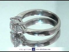 Round Three Stone Engagement Ring with Trillions from deBebians