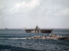 DD-660 passes between the photographer and Bunker Hill CV-17. The cruiser at left is either Pasadena CL-65 or Springfield CL-66, and USS Astoria CL-90 is partially visible off the port quarter of Bunker Hill.