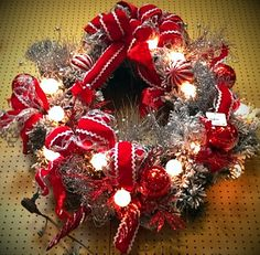 Red and silver wreath with white globe lights