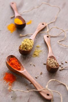 Herbs and spices in wooden spoons