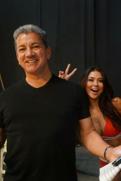 Arianny Celeste photo bombs Bruce Buffer backstage at UFC 166 weigh-in, Houston Toyota Center.