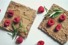 Pura Vida sprouted raw chia seed and cabbage bread with sunflower seed paste, fresh rosemary and raspberries!