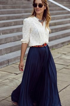 Lace shirt & maxi skirt #Streetstyle Like the broad shoulders, the sleeve length, the v neck, and the seams running down the front.  I would prefer a shorter skirt, but the belt and the pleats are very nice.                                                                                                                                                                                 More
