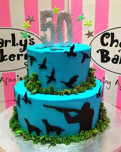 Hunting Themed Cakes | duck hunting themed 50th birthday 2 tier cake with hunter silhouette