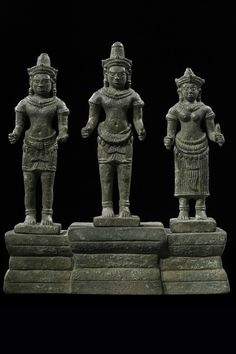 KHMER BRONZE TRIAD A Bronze Khmer Triad Early Angkor Wat Style 12th Century 18cm Provenance: Ex Douglas Latchford collection