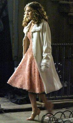 Zandra Rhodes white fur coat, Jill Stuart pink ruffle dress, and Manolo Blahnik pink diamante