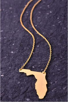 This gold or silver Florida necklace is perfect for year round! Support your favorite state, or school with this adorable charm necklace!