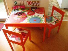 oilcloth on ikea kids table  (maybe trucks or equipment for Luke)