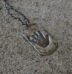 I got this dog tag for my husband for Christmas with Andrew's actual handprint stamped on it. They make keychains too that I ordered my dad. :) Very unique gift.