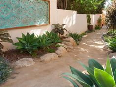 Decomposed granite (essentially, granite worn down into particles) is compacted into a rustic Southwestern-style path. Small boulders along the edge enhance the desert-like feel.