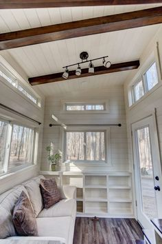 Mohican by Modern Tiny Living - Tiny Living The Mohican tiny house offers plenty of storage: Stairs, over-head kitchen, loft, downstairs closet, and cabinets around fridge. Tiny House Closet, Tiny House Living, Living Room, Tiny House 2 Bedroom, Modern Tiny House, Loft House, House Built, Rv Living, Kids House