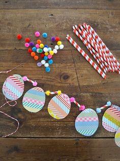 make egg garland with washi tape, straws and pom-poms