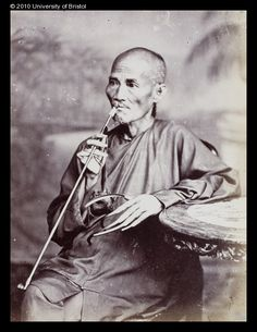 Old Chinese man with a pipe, ca. 1880-1890. This man's extremely long fingernails are demonstration that he could live comfortably without engaging in manual labour.