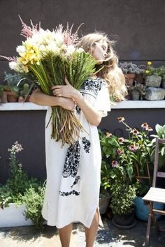 Fresh flowers, loose hair and an embroidered dress. I can't wait for summertime!