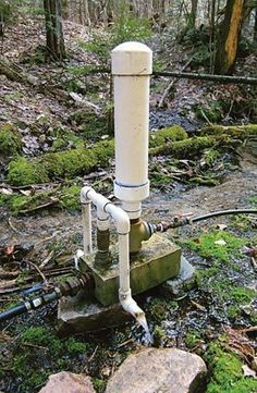 My Atlas Ram Pump; intake on left, delivery pipe on right. The large white pipe is the pressure chamber; to the left of it is a diverter for the waste water. Off The Grid, Ram Pump, Water Collection System, Solarium, Hydraulic Ram, Water Powers, Water Well, Water Storage, Water Conservation