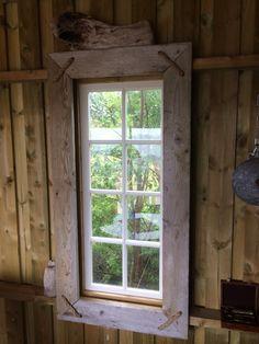 Drivved/driftwood window frame.