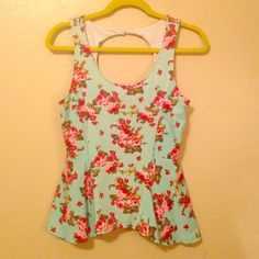 Floral Peplum Top, Peekaboo Back. Cute! Baby blue top with olive and red flowers. Tag says large, would fit small/medium. Kirra Tops