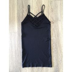 Black Strappy Cage Back Gym Tank Top This form fitted stretch tank is sure to be your new favorite. It features a cage strappy back. New. One Size Tops Tank Tops