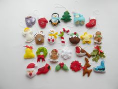 """Christmas felt ornaments set 25, advent calendar ornaments, tree ornament, Christmas decor, christmas tree decor. Christmas felt ornametns- advent calendar ornaments Set 25 This item is great for Christmas tree ornaments, table decoration, stockings, hanging on the door or any other type of decoration for Christmas. All made by hand (no machines involved). Then I hand-cut, hand-sewn each item with wool felt and lightly filled. Size for each of them is 2"""" x 2.5""""."""