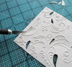 card making technique from Mel Stampz .... cut out areas of embossing folder designs ... back with interesting papers ...