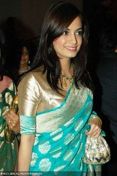 Diya Mirza in turquoise blue banaras georgette saree