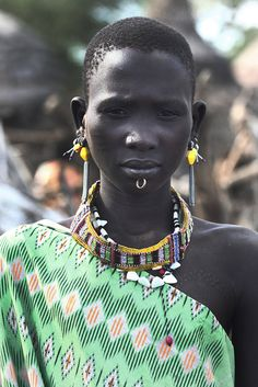 a woman of the toposa people, with traditional scarification, south sudan | traditional african culture