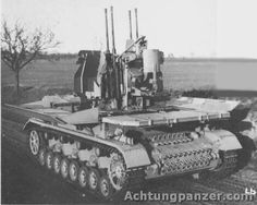 "A Flakpanzer 4 ""Mobilewagen"" positioned with the side panels down displaying the 2cm Flakvierling 38 anti aircraft gun mount"