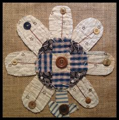 Flower created from vintage quilt and ticking....old buttons....hand stitching...by Brenda Henning
