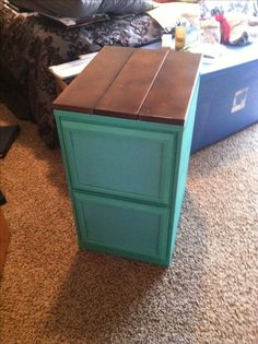 Filing cabinet re-do! Spray painted metal cabinet, painted picture frames with scrapbook paper glued to drawers and wood stained and glued to top!