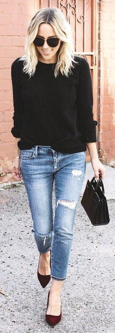 Black sweater + burgundy heels.