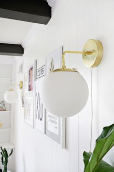 Brass globe sconce DIY using our LEDs with warm glow dimming effect! Having fun with of A Beautiful Mess Sconces Living Room, Wall Sconces, Living Room Decor, Wall Lamps, Dining Room, Bathroom Sconces, Ceiling Lamps, Wall Decor, Diy Wand