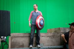 Joss Whedon on the green screen with Captain America's Shield.