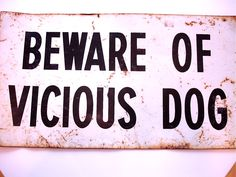 Beware of Vicious Dog rusted sign from Chuck Gammage's office.