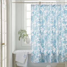Alyssa Shower Curtain with a charming all-over floral in lagoon blue on white.